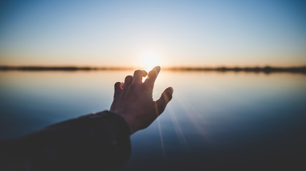 content future hand reaching sun