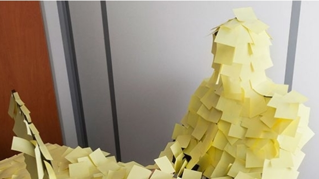 Articles figure covered in postit notes